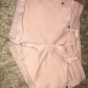 Light pink shorts.
